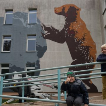 Visitors to Mosėdis are greeted by a modern work of street art